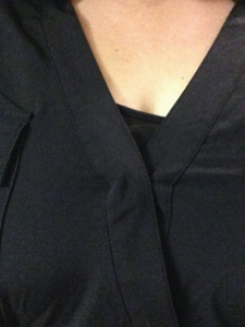 An awkward close-up of the snap on the wrap dress struggling to contain my ladies